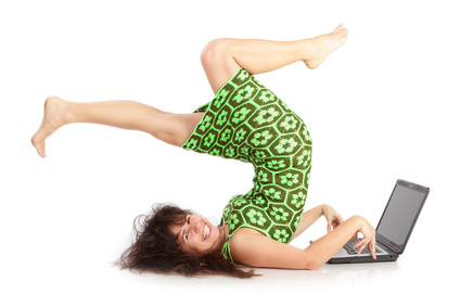 The flexible happy woman with the laptop  on a white background